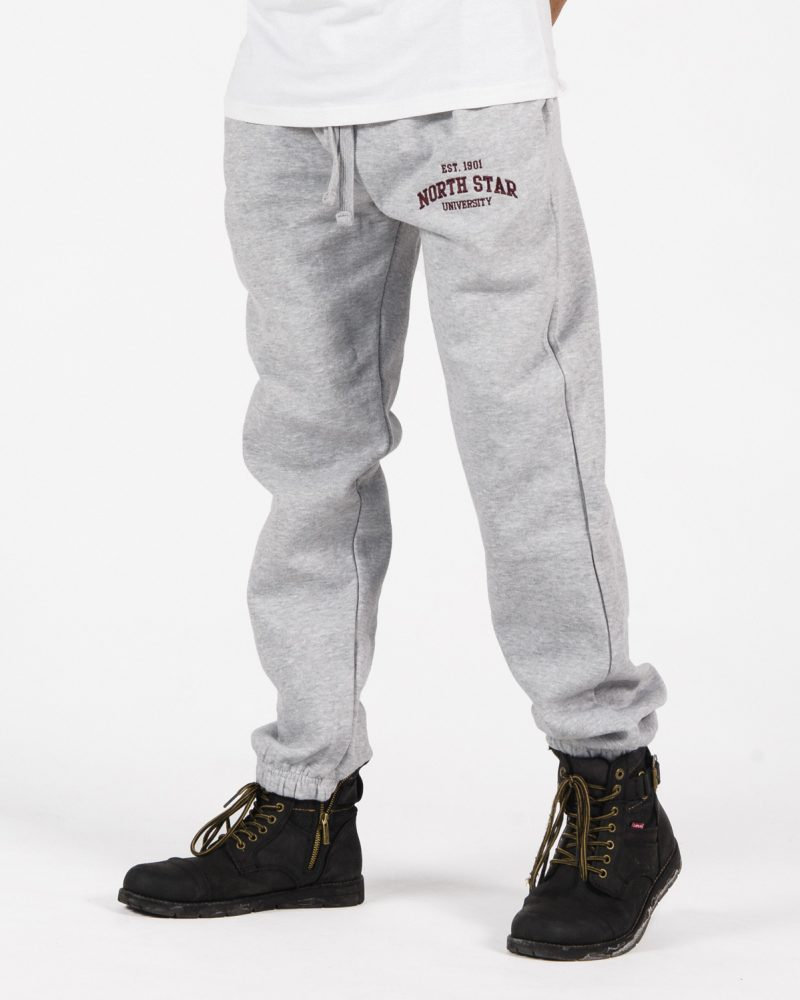 Premium Sweatpants 203 unisex fit in grey with burgundy embroidery on male model.